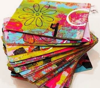a stack of colorful artists trading cards
